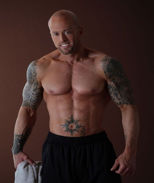 Tattooed Fitness & Sports Model John Quinlan